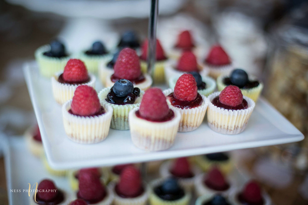 close up of berry cupcakes on dessert table at engagement Party in Montreal