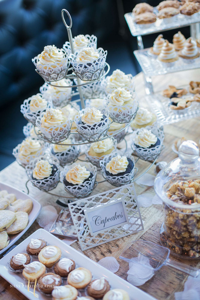 white vanilla cupcakes on wooden dessert table at engagement Party in Montreal