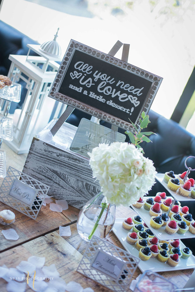 chalkboard sign on dessert table at engagement Party in Montreal