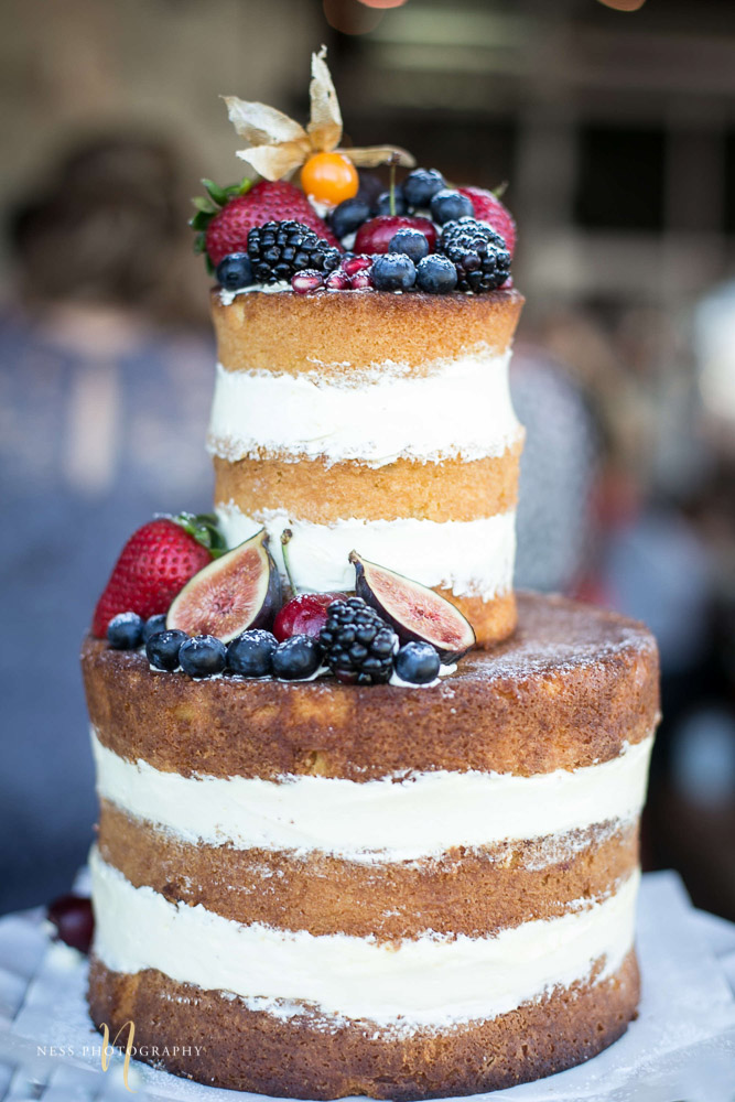 sharp image of nakes cake with berries on top by rustique pie at engagement Party in Montreal