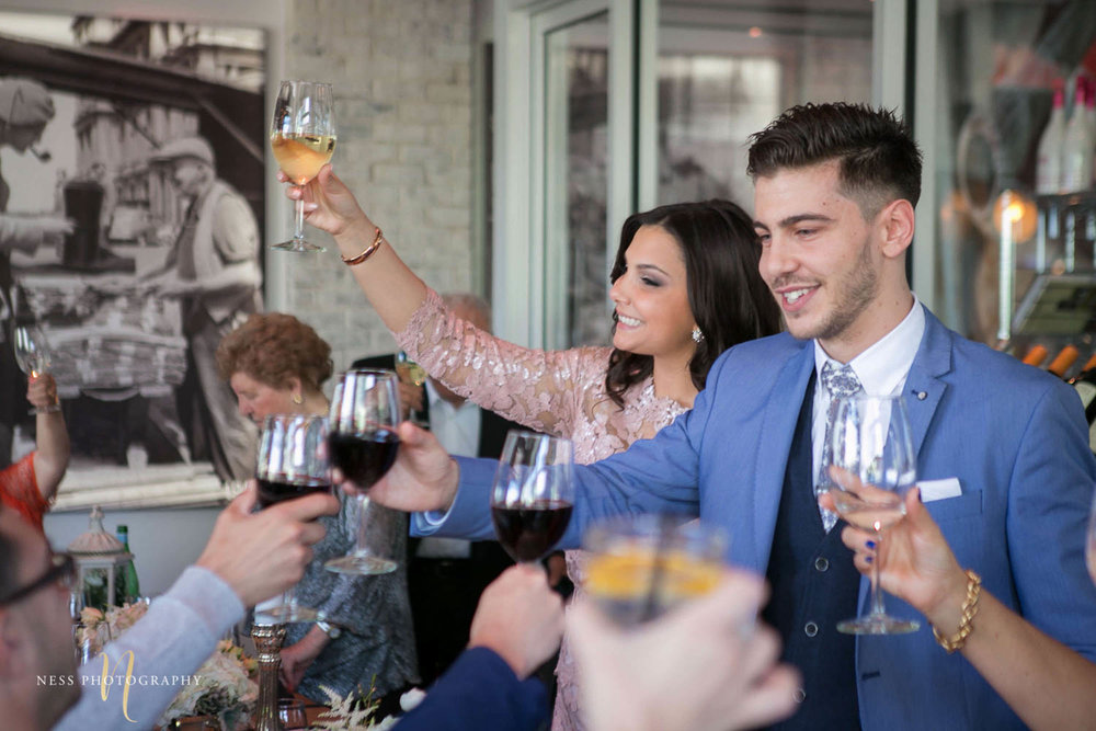 bride and groom to be cheering with guests at engagement Party in Montreal