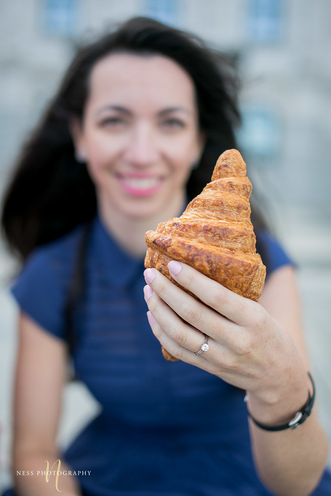 close up of engagement ring of bride holding a croissant from maison christian faure in fete du croissants montreal