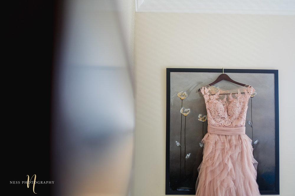 blush wedding dress hanging for montreal elopement
