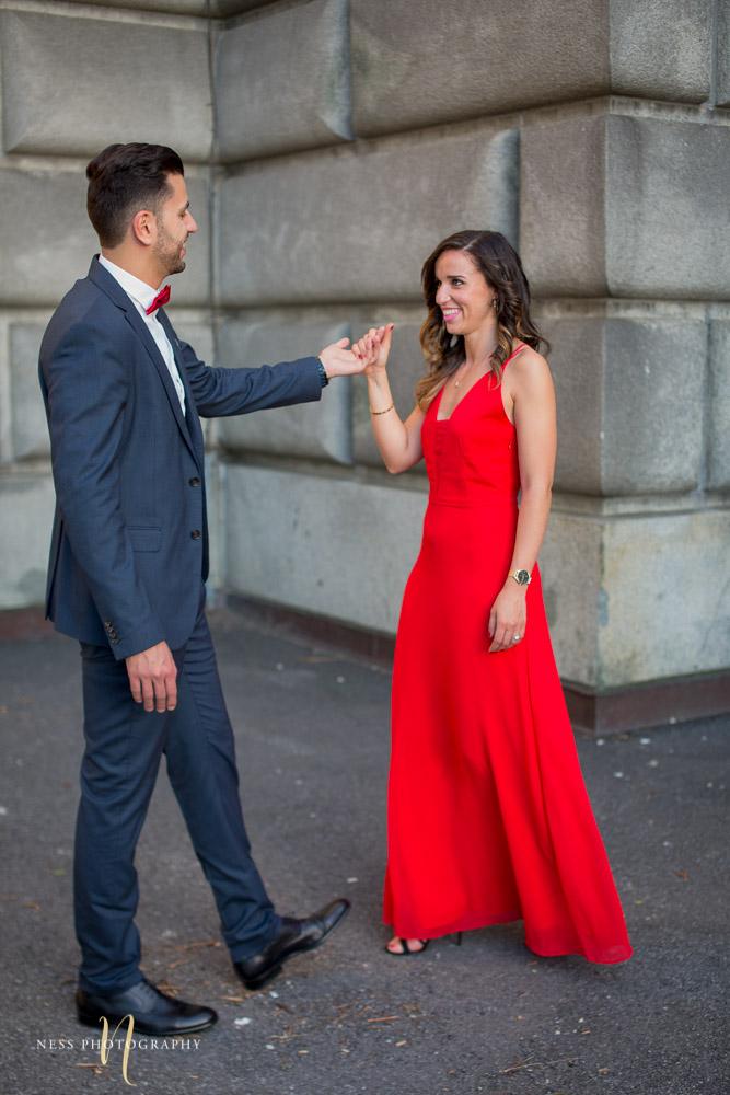 couple walking towards eachother at montreal saint joseph oratory engagement photoshoot