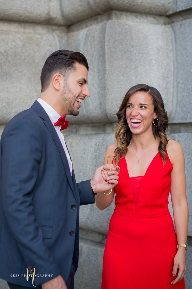 couple looking at each other and laughing during montreal engagement photoshoot at oratoire saint joseph