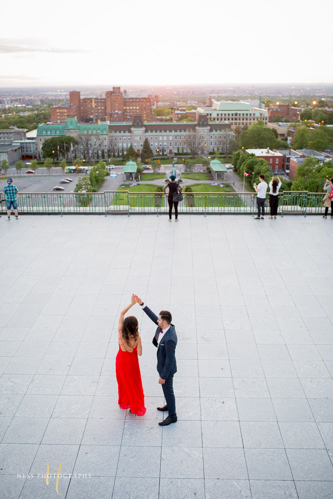 couple dancing with montreal sunset view during engagement session at saint joseph oratory