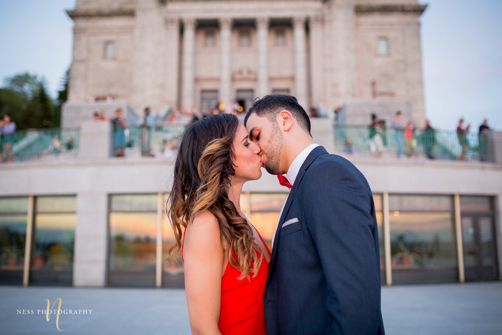 couple kissing during montreal engagement session at saint joseph oratory with montreal wedding photographer