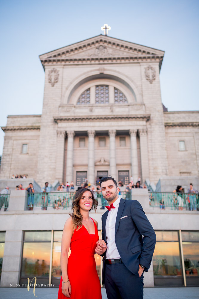 couple watching sunset at saint joseph oratory during montreal engagement photoshoot