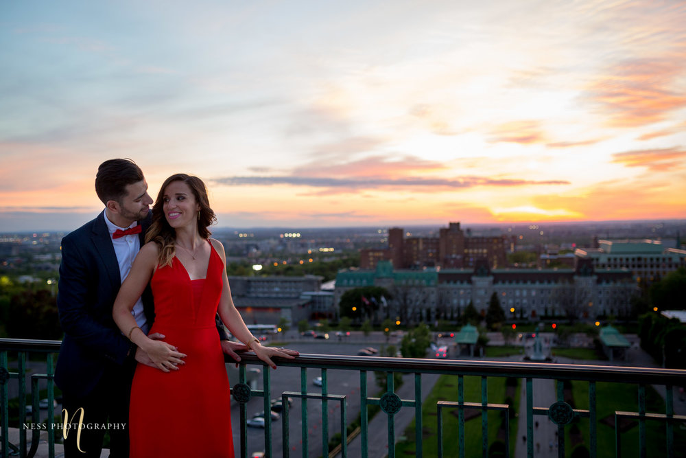 couple posing infront of sunset with montreal view at saint joseph oratory