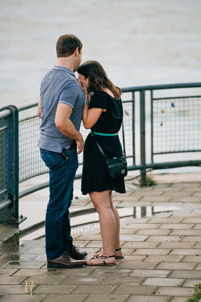 couple hugging and crying after surprise proposal in old montreal clock tower