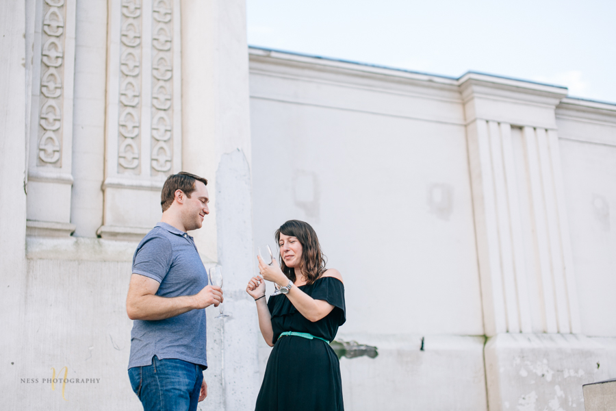 Surprise proposal  with champagne in montreal old port clock tower by ness photography montreal wedding photographer  6.jpg