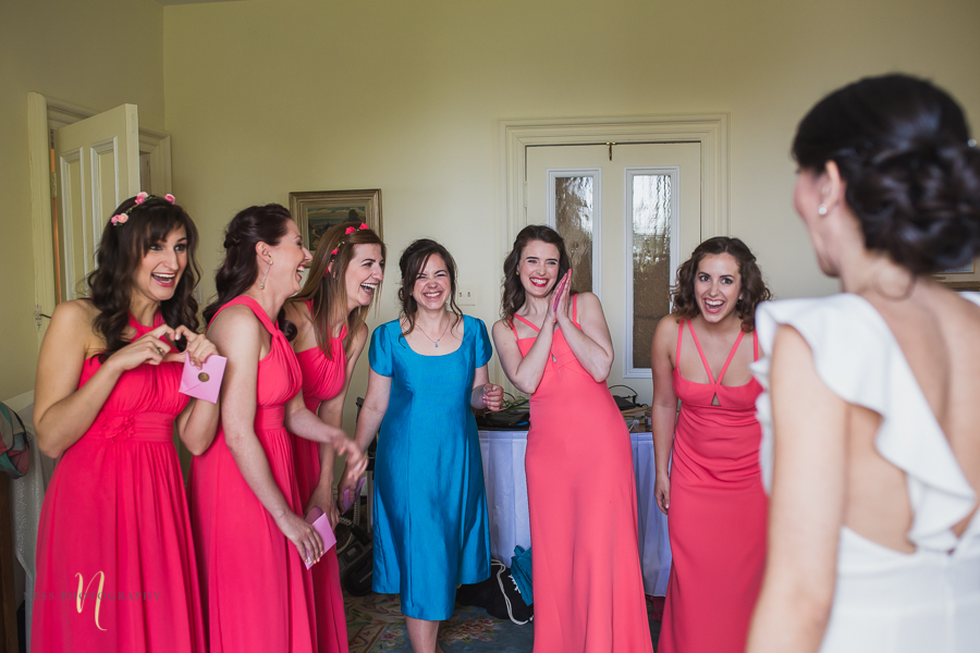 bridesmaids surprise when they see the bride during Wedding at Forest and Stream club by Ness Photography
