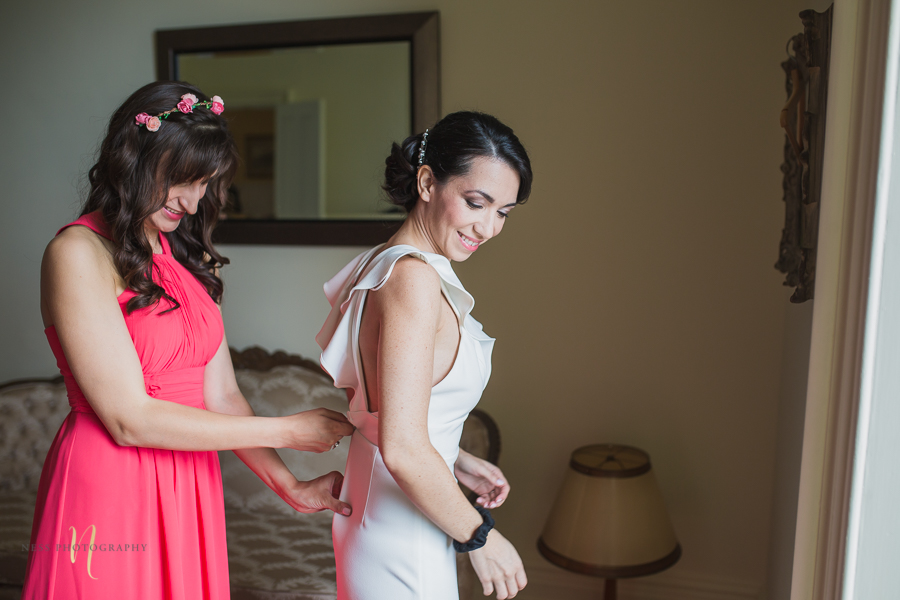 bride getting dressed at Wedding at Forest and Stream club by Ness Photography