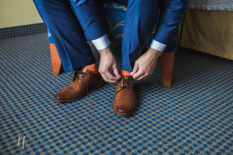 groom putting his shoes on at Forest and Steam Club Wedding by Ness Photography Montreal wedding photographer- groom getting ready-9.jpg