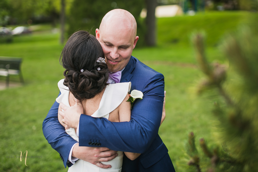bride and groom hugging at Wedding at Forest and Stream club by Ness Photography