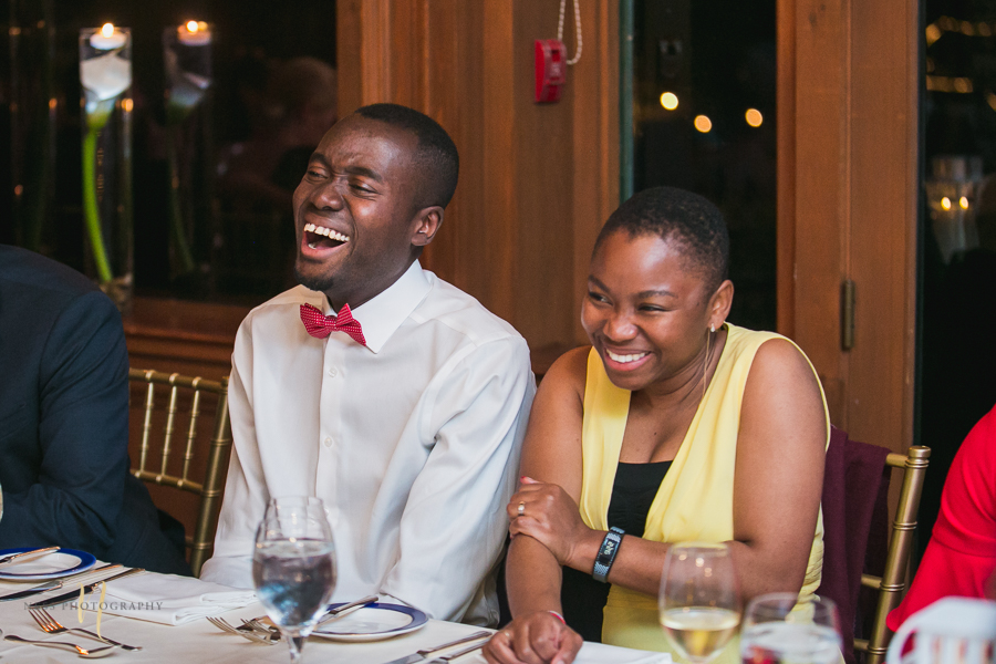guests laughing at at Forest and Stream club wedding  by Ness Photography