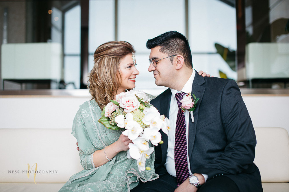 Bridal photos for pakistani wedding in Montreal old port- bride andg room on couch