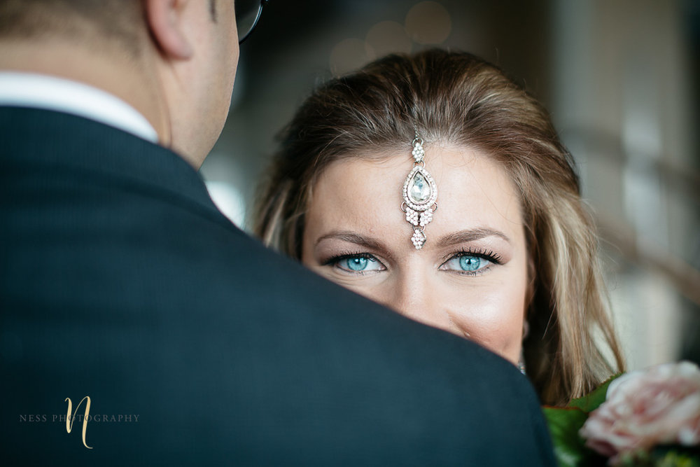 Bridal photos for pakistani wedding in Montreal old port-- bride with bleu eyes and blond hair