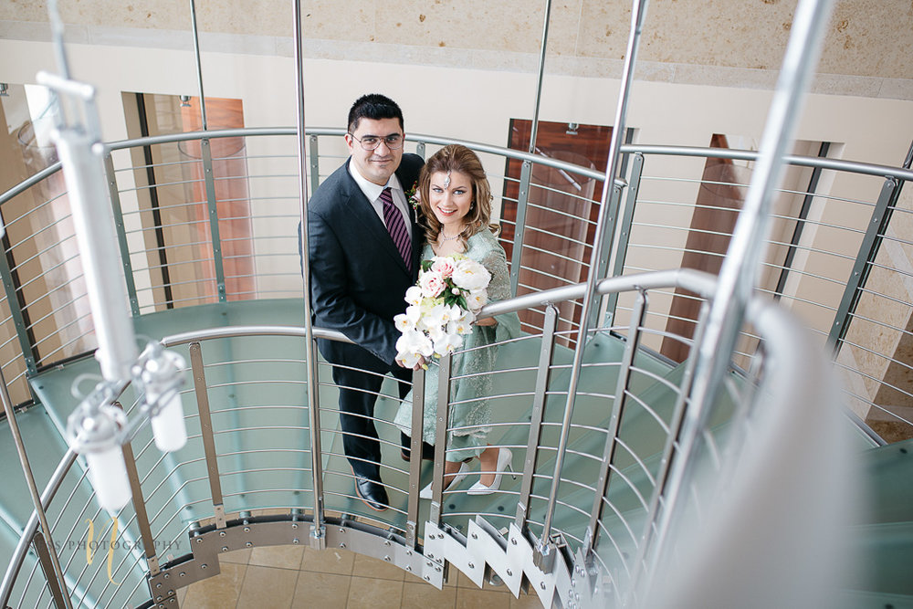 Bridal photos for pakistani wedding in Montreal old port-- bride and groom on the stairs