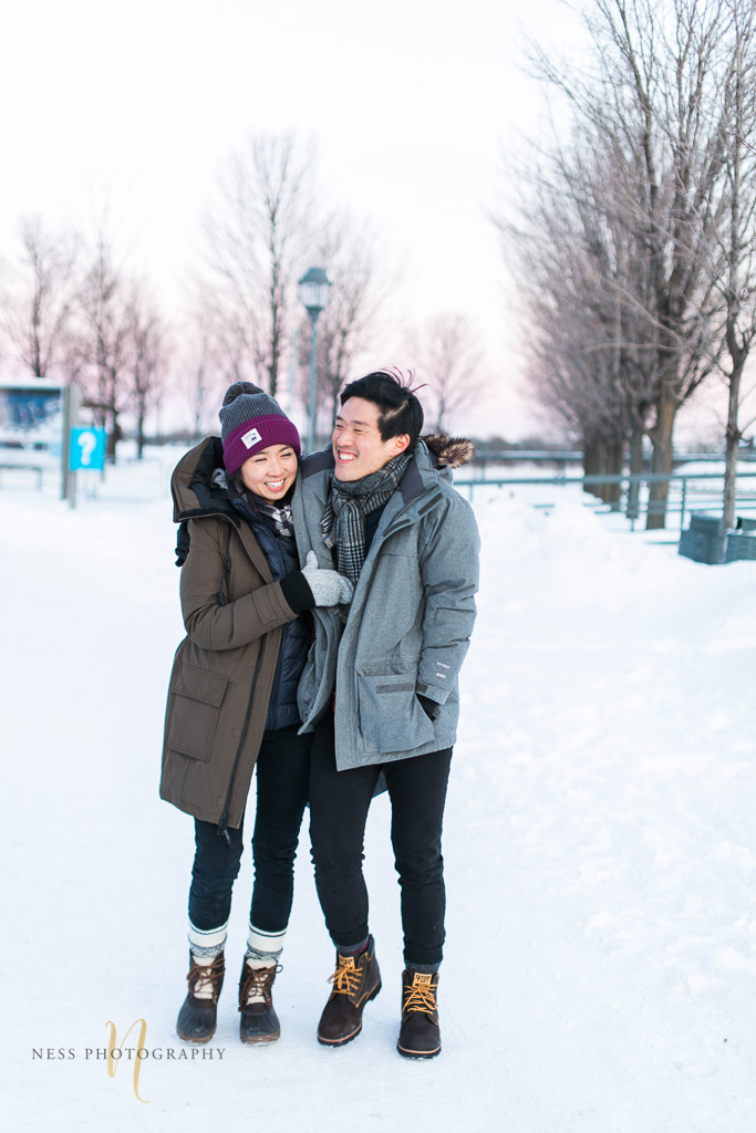 couple walking together at winter sunset engagement photoshoot in montreal old port