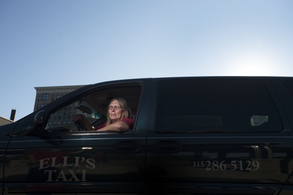 Ruby Stevens, 57, inside her taxi on Friday, Sept. 22 2017 in Watertown. Fort Drum military base has created tougher contracts that make it difficult for small taxi companies to operate on base.(Christian K. Lee/Watertown Daily Times)