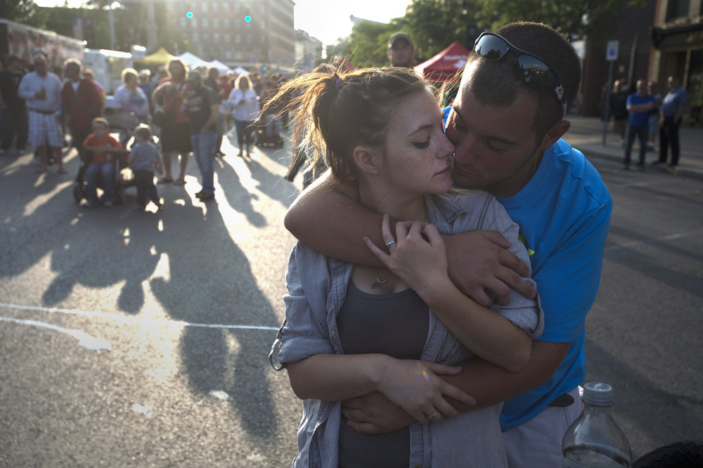 Karlie Fancher, left, is held by Stephen Gorri during the downtown block party at Public Square on Friday, Aug. 25 2017 in Watertown, New York.(Christian K. Lee/Watertown Daily Times)