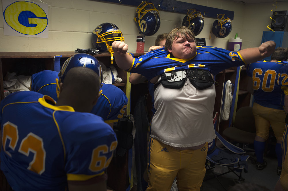 Gouverneur's Brandon Stevens (76) gets pumped up while putting his uniform on before a high school football game against Massena at Gouverneur High School on Saturday, Sept. 2 2017 in Gouverneur, New York. Gouverneur won 36 to 12.(Christian K. Lee/Watertown Daily Times)