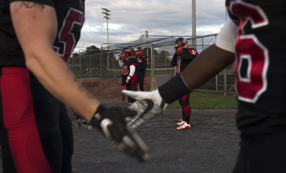 Watertown players shake hands as their teammates prepare for a semi-pro football game at the Watertown Fairgrounds on Saturday, Sept. 9 2017 in Watertown, New York.(Christian K. Lee/Watertown Daily Times)