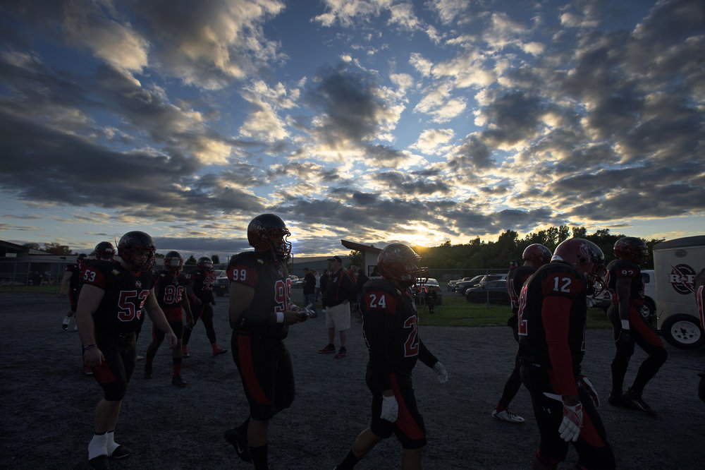 Watertown players walks onto the field before a semi-pro football game at the Watertown Fairgrounds on Saturday, Sept. 9 2017 in Watertown, New York.(Christian K. Lee/Watertown Daily Times)