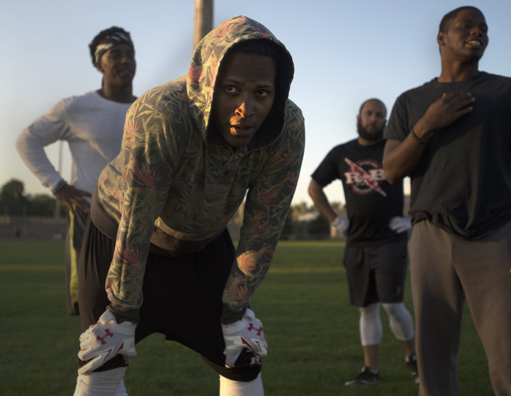 Mark Benjamin catches his breath after him and his teammates complete a drill during their football practice at the Alex T Duffy Fairgrounds on Tuesday, Sept. 12 2017 in Watertown, New York. The athletes are members of the Red and Black semi pro football team.(Christian K. Lee/Watertown Daily Times)