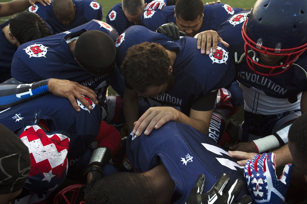 Revolution players pray before a semi-pro division championship game against Southern Tier Diesel at Carthage Central High School on Saturday, Sept. 16 2017 in Carthage. Revolution won 53 to 6.(Christian K. Lee/Watertown Daily Times)