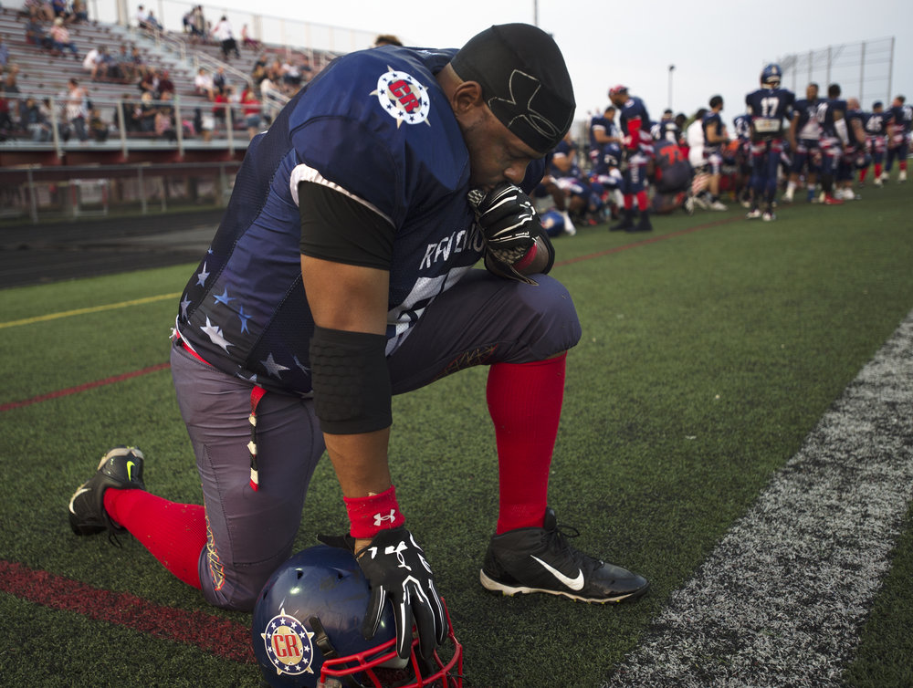 Revolution's Jon Fisher (55) pauses before a semi-pro division championship game at Carthage Central High School on Saturday, Sept. 16 2017 in Carthage. Revolution won 53 to 6.(Christian K. Lee/Watertown Daily Times)