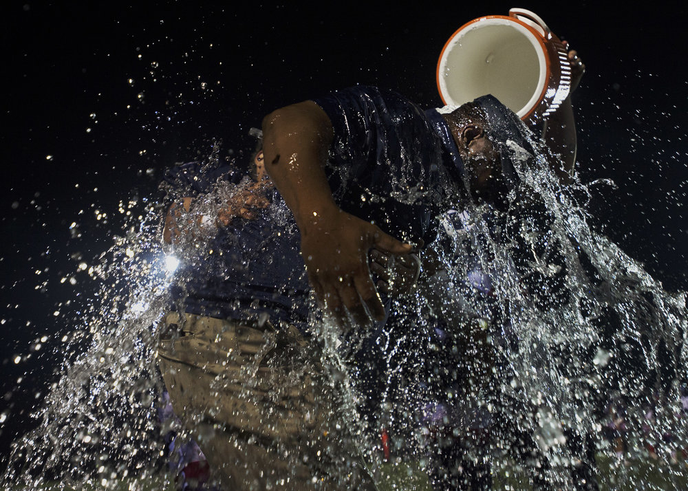 Revolution's Eric Johnson is drenched in water after his team won a semi-pro division championship game at Carthage Central High School on Saturday, Sept. 16 2017 in Carthage. Johnson is the defensive coordinator of the team. Revolution won 53 to 6.(Christian K. Lee/Watertown Daily Times)