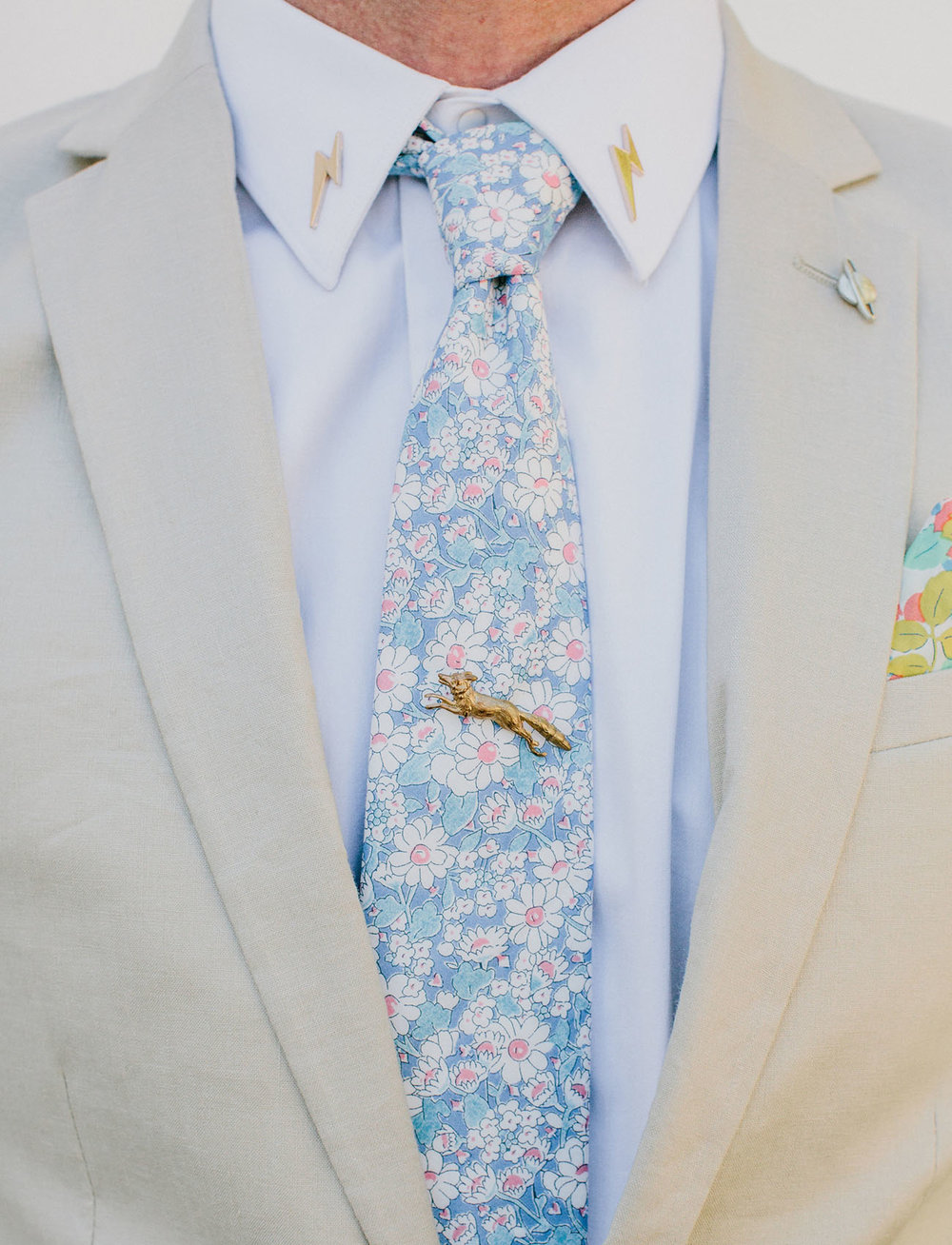 We're diggin' this floral tie + linen suit from  ASOS  (perfect for the beach wedding, might we add).