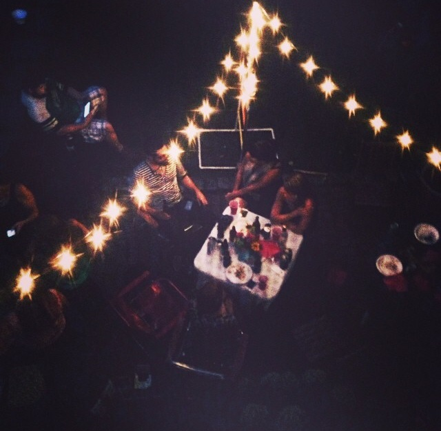 Gather friends under twinkling lights and a feast of tacos. Happiness is bound to ensue. Photo by Alex Heide