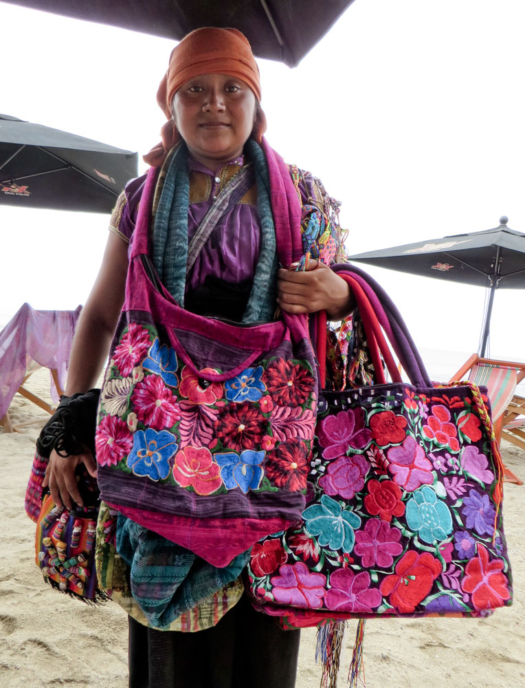 043-vendor-with-brightly-colored-bags.jpg
