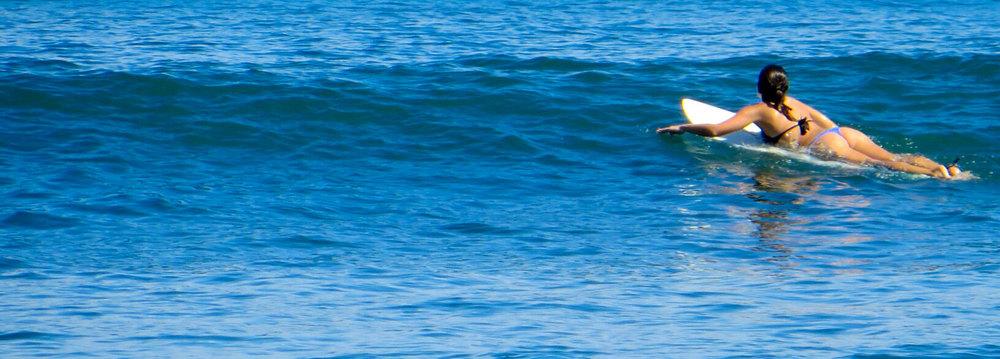 086-Sayulita-girl-paddling-surfboard.jpg