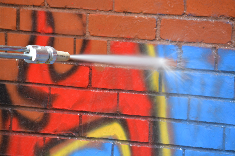 Easily remove unwanted and unsightly graffiti from brick or siding!