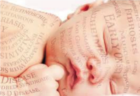 Image of a small baby with numerous words related to pre-natal testing projected across its body.
