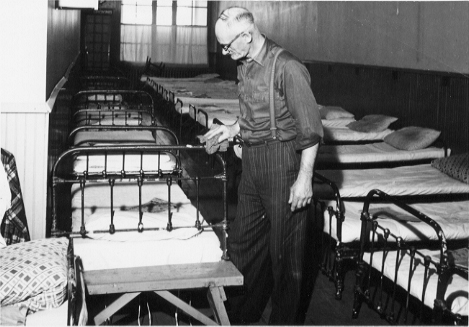 Man polishing beds