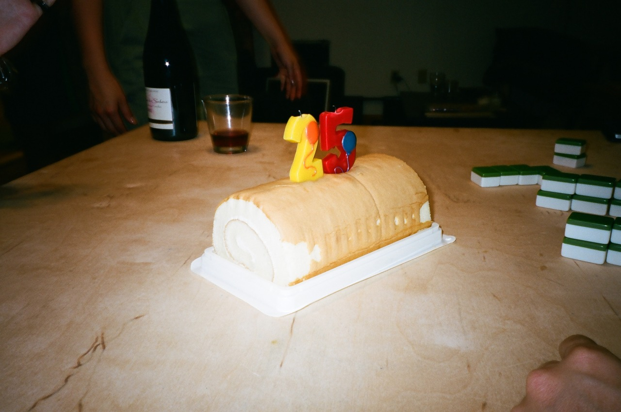 25 is Mahjong, wine, and roll cake