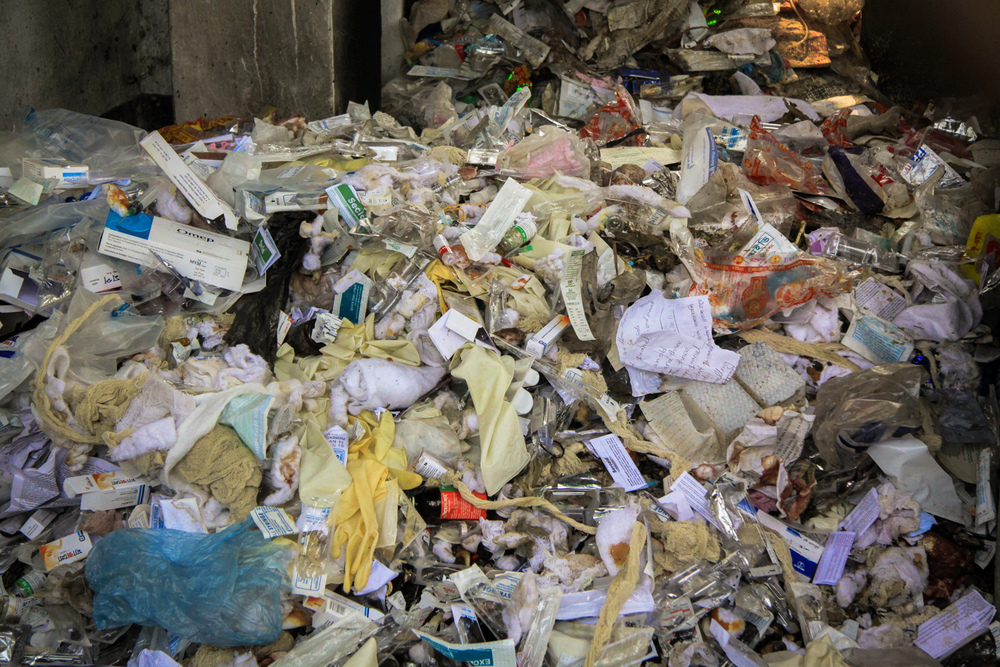 Fresh waste waiting to be dug through by waste pickers, who then sell used and infectious sharps and toxic containers on the public market