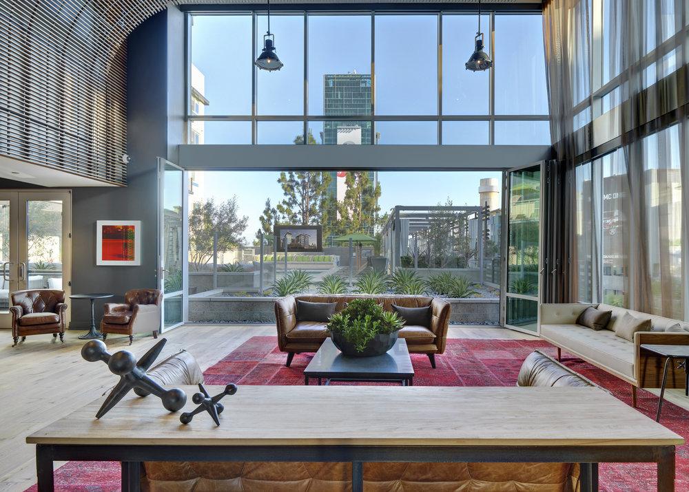 The_Camden_Hollywood_Apartments_The_Hub_Interior_Facing_Pool.jpg