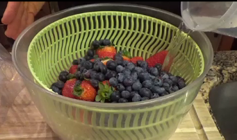 2) Gently place the berries in the colander part.  Gently fill the bowl with water, so that the berries float.