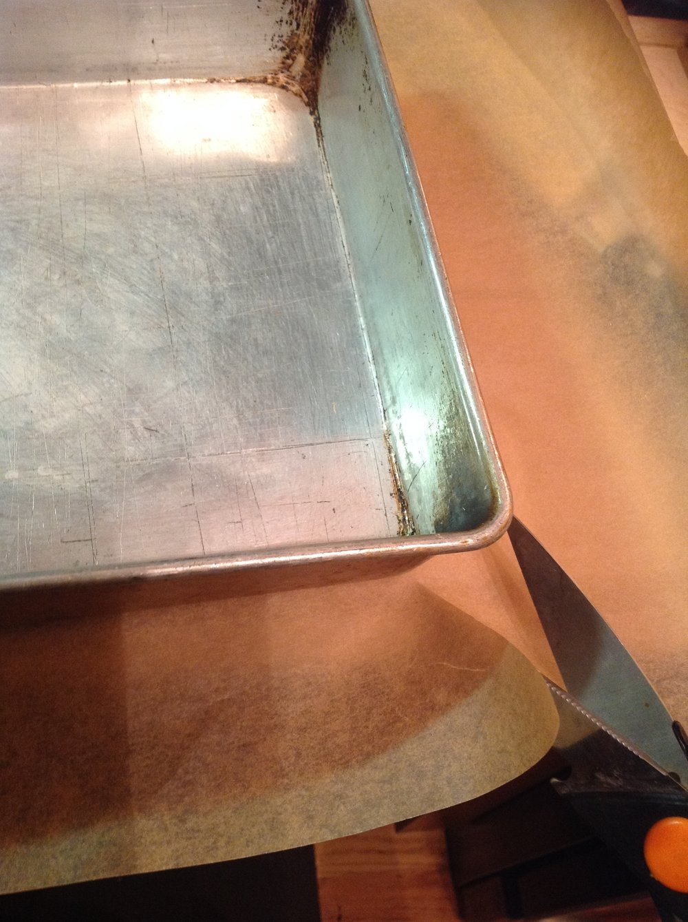 Chef's Tip - Cut into the corners of your parchment to make it easily fit your square baking pan