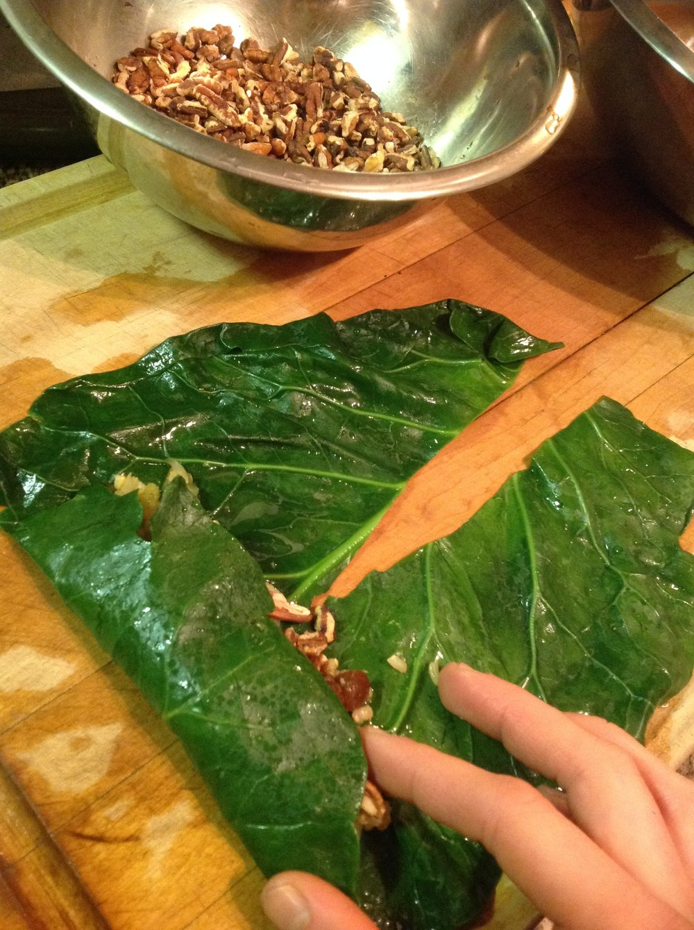 "Chef's Plant-Based Tip: Roll the Collards just like you would a burrito.  Tuck in the ends, then roll from big end to the ""tails"".  You can use with any healthy filling like beans, potatoes, or quinoa.  This makes a satisfying, gluten-free, nutritious vegan meal"