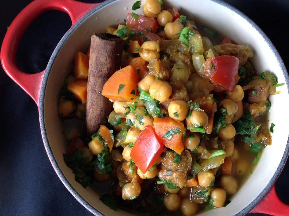 Chef's Tip: Garnish the tagine with fresh tomatoes and herbs to add bright, healthy flavor and beautiful color for this vegan, oil-free recipe
