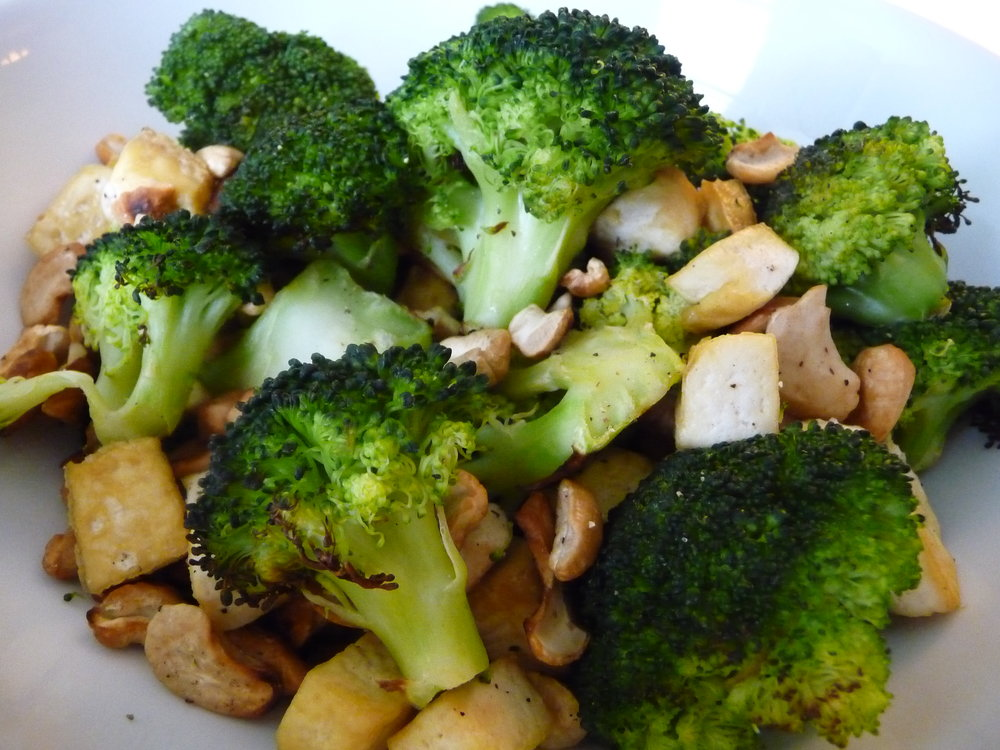 Chef's Tip: Roast Broccoli with cashews and tofu for a healthy, oil-free crunchy dish.  This makes an easy vegan side, great for some Asian flavor at a potluck or dinner party.