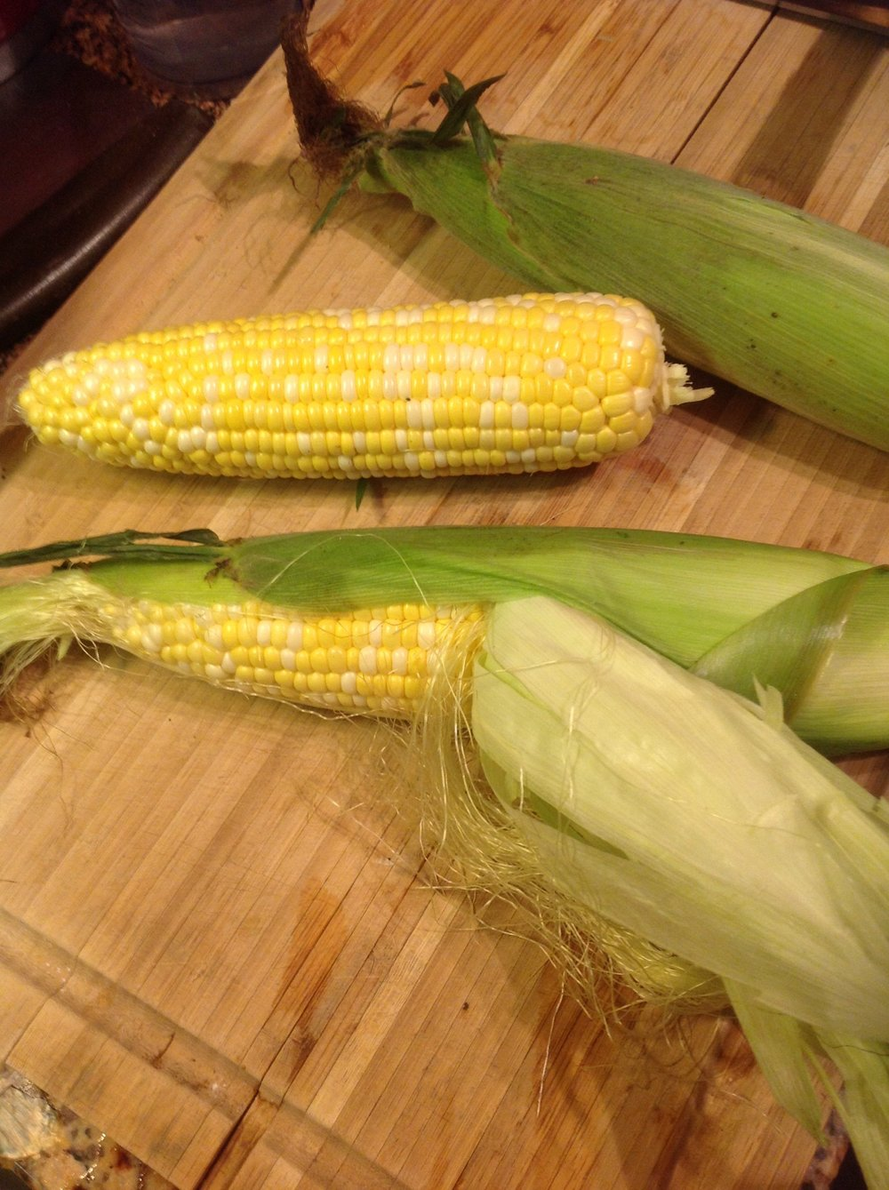Chef's Tip:  To keep the sweetest flavor, shuck corn right before you're going to cook it.  As corn sits in the fridge, the sugars start to convert to starch.  Use it soon!