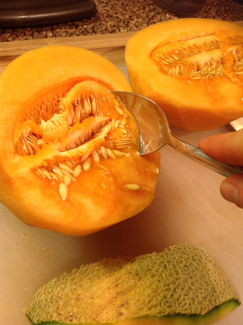 Chef's Tip:  Use a large spoon to scoop out the seeds of melon.  Try to keep as much juice as possible.  Work over a bowl or a cutting board with a grooved edge to help catch these sweet juices